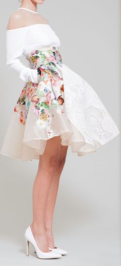 White tasteful dress with sheer shoulders and floral skirt by hussein bazaza SS 14