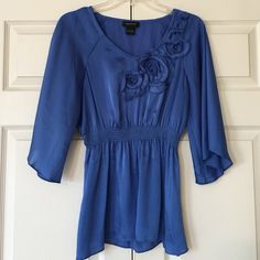 Satin Blue Blouse Satin, 3/4 sleeve blue blouse with beautiful floral design on top! Gently used but in excellent condition! No stains, marks, nor rips! Price is negotiable and I'm always open to offers. NO TRADES spense Tops Blouses