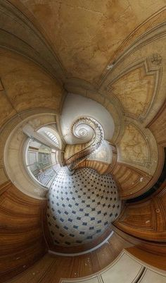 The famous stairs of the Galerie Vivienne by Vincent Montibus (Photo taken with a fish eye lens gives an Alice in Wonderland effect.)