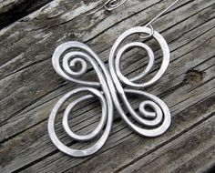 Celtic Knot Infinite Swirl Cross Ornament - Aluminum Wire Christmas Ornament - Holiday Ornament. $16.00, via Etsy.