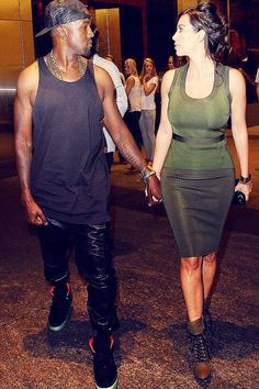 "Kanye West and Kim Kardashian; walking away from the ""Birthday Song"" video set"