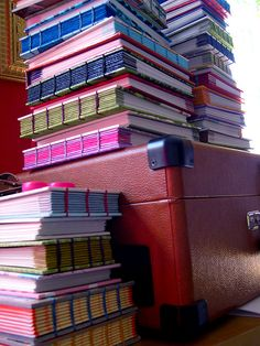 Stack of Colorful Coptic stitch journals made by Kate Black