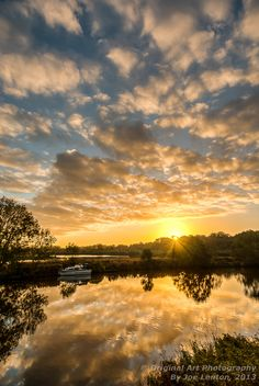 As the sun peeks over the horizon, we get a lovely sunstar effect. The dramatic clouds reflect off the water of the river Cloud Photos, Sunset Images, Us Images, Fine Art Gallery, Norfolk, Beautiful Images, Art Photography, Sunrise, Original Art