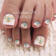 Turquoise and gold Jewel pedicure design.