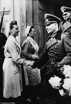 """Nazi General Erwin Rommel greets Nazi nurses in 1943. The article is also very interesting. Aryan-looking children were taken from their homes in an effort to build up the """"super-race."""" Children with brown hair underwent UV treatment in an effort to make their hair appear lighter."""