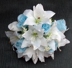 A beautiful bouquet from our Romance range comprising of light blue roses and white lilies The bouquet is inches) in length including the handle and the flowers have a diameter of approximately inches). Lilly Bouquet Wedding, Blue Rose Bouquet, Prom Bouquet, Bridesmaid Bouquet White, Hydrangea Bouquet Wedding, Bridal Bouquet Blue, White Wedding Bouquets, Lily Wedding, Blue Bridal
