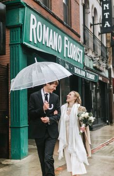 Cannolis, snow, rings, oh my! This winter wedding at Boston City Hall was simply perfect. The bride wore a knee-length lace dress and camel peacoat, the groom rocked a black suit, and they shared a cute clear umbrella to hide from the rain and snow! To warm up, they shared limoncello and cannolis at Caffe Vittoria in the North End of Boston. Rain, shine, wind, snow, Boston is the BEST place to elope! Check out more of Lena Mirisola's epic city elopements. City Hall Wedding, Post Wedding, Wedding Photos, Boston City Hall, Boston Public Garden, Camera Shy, Courthouse Wedding, Couples In Love, Beautiful Couple