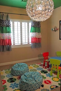 Adorable curtains for a girls bedroom or playroom...love the fab light fixture, rug, and bean bag chairs