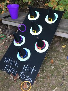 Creative Halloween Project This ring toss game was a hit at our elementary school Harvest Festival. Use a colored foam board or wooden plank for the base. Then make witches hats from construction p…