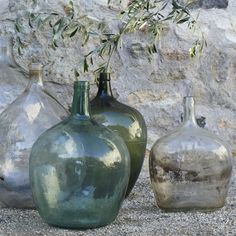 """Coveted by interior designers and antique glass collectors, Demijohn bottles are versatile and decorative. They've certainly made the rounds in blogland over the last few years, but I just can't help but re-visit these colorful bottles each spring."" - Blogger Jamie Wood (http://www.veccostudio.com)"