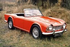 Triumph TR4 (1963) Hello, I'm a red Triumph, in the woods, with my top down. Any argument you may or may not throw is automatically invalid. When new (when new!), these could easily reach 110mph, which was respectable for a light convertible.