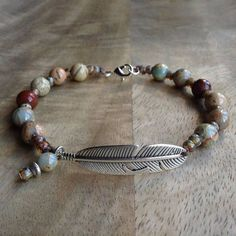This beaded gemstone bracelet is made with, Impression jasper beads 8 mm,miyuki beads, a metal lobster clasp and a metal feather bead. Fits a wrist of 19 cm = 7.48 inch. Please read my policies before ordering. #gemstones