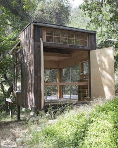 Topanga Tiny Cabin. I like the way it's built on a platform, the natural barnboard siding, how it opens to the outside, and how it is in an entirely natural setting.