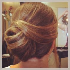 Modern French twist with swoop.