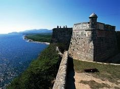 Sitting atop a 200-foot-high peninsula at the entrance of the Santiago de Cuba Bay, San Pedro de la Roca Castle was built in 1638 to protect the port of Santiago from piracy because of conflicts between Spain and England. Converted to a prison in the 1800s, the former fortress now acts as a pirate museum and is considered one of many fortresses that helped define Cuba during the 17th century.