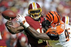 Cincinnati Bengals defensive end Carlos Dunlap sacks Washington Redskins quarterback Robert Griffin III and forces a fumble during the first half of an NFL football game in Landover, Md., Sunday, Sept. 23, 2012. (AP Photo/Nick Wass)