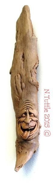 """Alder Nut""     16¾ inches tall, 3½ inches at his widest.  This nutty guy is carved into an unusual piece of Red   Alder driftwood but no, Alders don't actually grow nuts.  Signed and dated:   N. Tuttle 6/13/15"