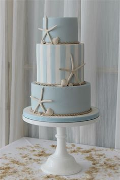 Planning a seaside themed wedding? This light blue wedding cake complete with star fish adornments is ideal for a beach themed wedding #cakes #seaside #beach