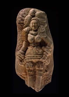 Plaque with yakshi (nature spirit) or mother goddess. Terracotta moulded plaque. Exceptional for its elaborate ornament and fine detailing, this famous terracotta was discovered in 1883 in a river bank at Tamluk, the ancient sea port of Tamralipti on the Bay of Bengal.