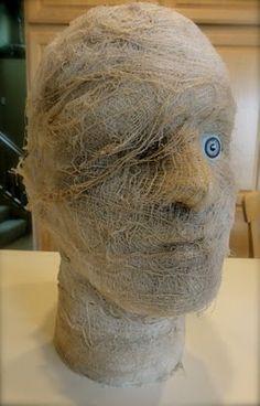 Mummy Head using a styrofoam head, a doll eye, and coffe stained gauze. #DIY