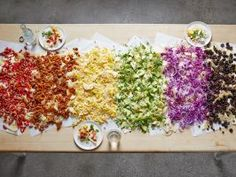 Bigger Is Better! : This game-day classic gets supersized with a literal rainbow of toppings, creating the perfect dish to feed a crowd. They take some work, so be sure your game plan includes prepping most of the toppings a day ahead and scouting out a clear space at least 7 feet long to accommodate this massive pile of chips — a folding table or kitchen counter will work well.