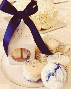 Our French Macarons make the prettiest wedding favors. Clients often have a box of these delicacies at each place setting. We have a smaller, clear box that holds 1 macaron or this larger box that holds two. The choice is yours! #weddingfavors #atlanta #atlantawedding Macaron Boxes, Atlanta Wedding, Place Settings, Macarons, Wedding Favors, Cakes, Table Decorations, Lantern, Showers