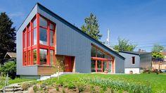 Red window frames accent angular Seattle house by Stettler Design | Dezeen