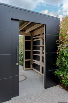 "Designer garden house ""black box"" in Munich by design garden of Augsburg, . - Designer garden house ""black box"" in Munich by design garden of Augsburg, Germany UV - Black Box, Design Cour, Free Standing Pergola, Carport Designs, Carports, Bike Shed, Garden Buildings, Yard Design, Black House"