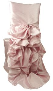 Chair covers - SOOO many cute ones.  Saw these on My fair wedding with David Tutera