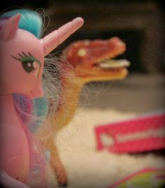 Not a Dinovember but a Toycember? Celestia is cheating Raptor in Hello Kitty board game.