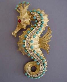 SEAHORSE brushed gold tone seahorse brooch with aqua beads, clear and red rhinestones.