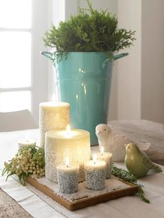Bird Nature Centerpiece  Your tabletop will twinkle with candles covered in a dusting of faux flurries. To make, pour Epsom salts onto a flat surface. Sprinkle in glitter, then mix. Apply a layer of decoupage adhesive to the candle sides using a paintbrush or foam brush. 1 day I will be able to have this!