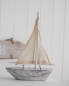 A decorative white wooden sailing boat