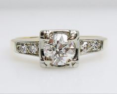 We love the the round diamond in the square setting of this Vintage Diamond Engagement Ring #vintage #sidestones #engagement