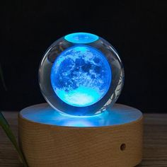 Decorate your home, office or sacred space with a perfectly-crafted laser engraved Moon Crystal Ball. Engraved by a high precision computerized laser, this crystal Earth fits perfectly in any room. Laser Engraved Gifts, Science Tools, 3d Laser, Crystal Ball, Glass Crystal, Crystal Decor, Glass Ball, Home Design, Laser Engraving