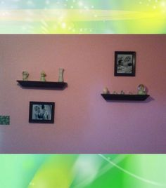 I spray painted the shelfs & frames to match her room. I'm going to add more frames later