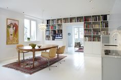 dining room makeover by adding built-in book shelf. nice before and after photos. via turbulences-deco.