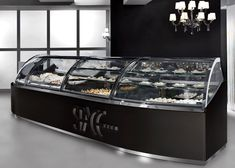 Space, traditional, curved top, gelato, pastry, frozen, or refrigerated display case. www.AdvancedGourmetDisplays.com