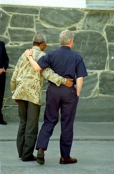 President William J. Clinton walking with President Nelson Mandela on Robben Island, South Africa. March 27, 1998.