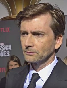 David Tennant very concentrated on the questioner