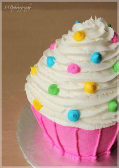 Smash cake, Aunt @Sydney Sorensen I may need to borrow your cupcake cake tin!