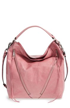 Asymmetrical zip pockets lend to a moto vibe on a slouchy hobo bag from Rebecca Minkoff. Super cute and spacious!