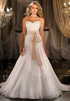 Gown features beading and lace. Sash available separately.