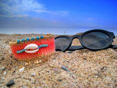 Items similar to Cuff Handwoven Friendship Bracelet. Sea Shell in Coral on Etsy Beach Bracelets, Yoga Bracelet, Bohemian Jewelry, Sea Shells, Friendship Bracelets, Hand Weaving, Beading, Coral, Glasses