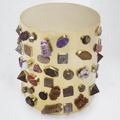 Kelly Wearstler's Bejeweled Stool $32,200. Crafted by artisans in Los Angeles, the Bejeweled Stool features a variety of hand-selected, semi-precious stones bezel set onto a bronze body. Stones include a mixture of lapis, pyrite, druzy, turquoise, malachite, & labradorite, hand picked by Kelly. The Bejeweled Stool is available in bronze, which will develop a rich antique luster over time. Each stool features a completely unique collection of semi-precious stones; no two are completely alike.