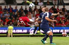 Former France and Manchester United striker Louis Saha attempts a bicycle kick