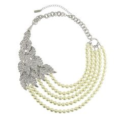 Swarovski leaves and pretty pearls romantically drape across, adding a dramatic and flawless finish.