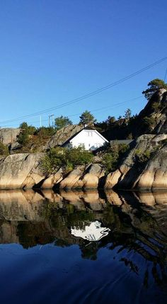 reflection, water, rock - object, clear sky, nature, tree, no people, day, lake, mountain, outdoors, tranquility, blue, waterfront, architecture, bridge - man made structure, sky, scenics, built structure, beauty in nature