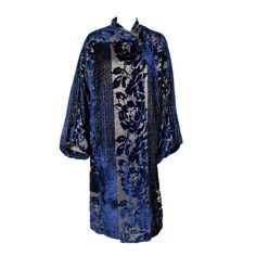 Dark sapphire blue devoré silk velvet and gold lamé opera coat | France (probably), 1920's | Coat features an Art Deco floral pattern framed by wide bands of geometric panels, wide kimono style sleeves and asymmetrical collar that fastens with a fabric covered button
