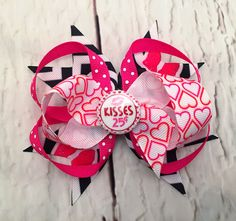 A personal favorite from my Etsy shop https://www.etsy.com/listing/493003326/valentine-kiss-hairbow-pink-red-heart